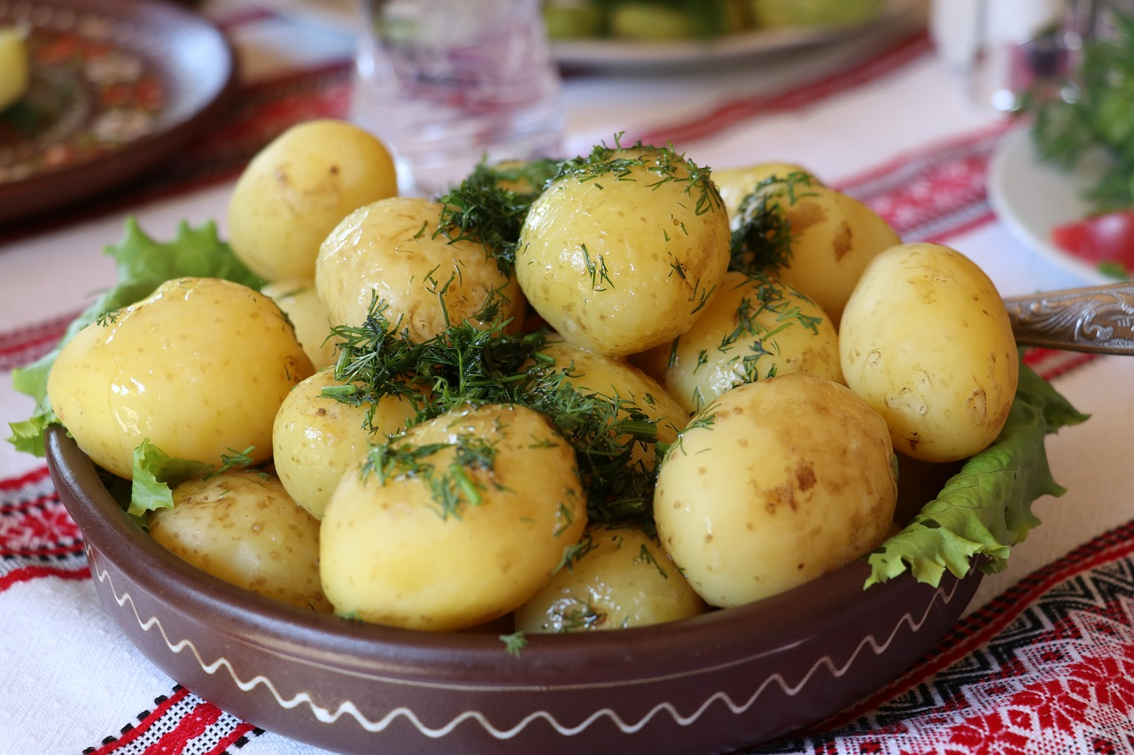 dish of boiled potatoes sprinkled with herbs