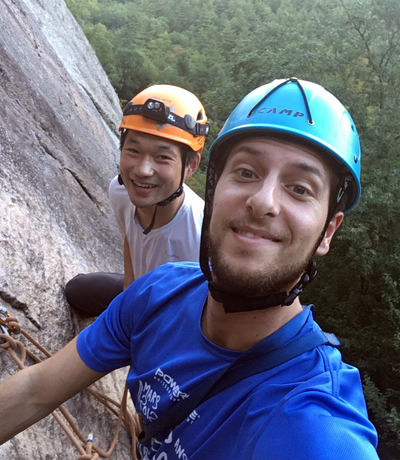 David Ding and Enrico Calvanese scaling a rock cliff