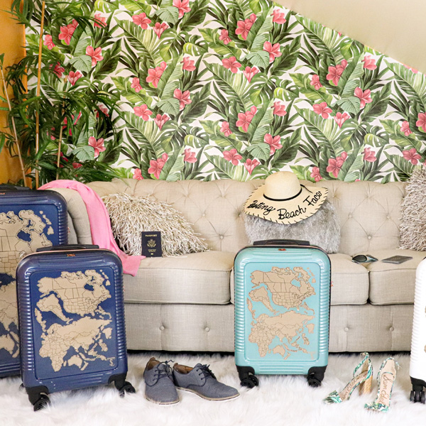 luggage with a beach hat and a tropical motif