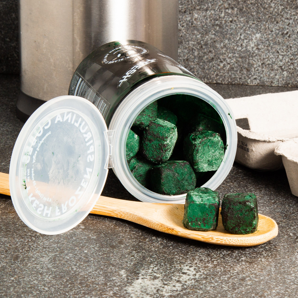 We are the new farmers canister of green blocks of spirulina